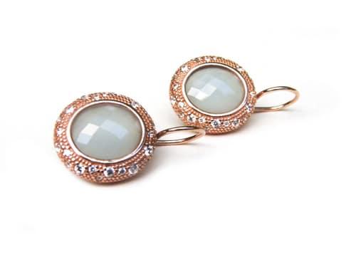 oorringen oorbellen in zilver roosgoud verguld met gekleurde lichtblauwe steen en cubic zirconia