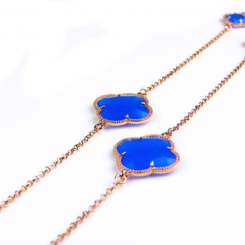 lange zilveren ketting roosgoud verguld met fel blauwe stenen klavers bloemen