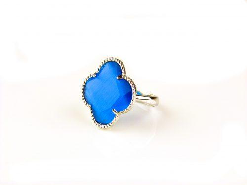 zilveren ring blauwe steen klaver bloem