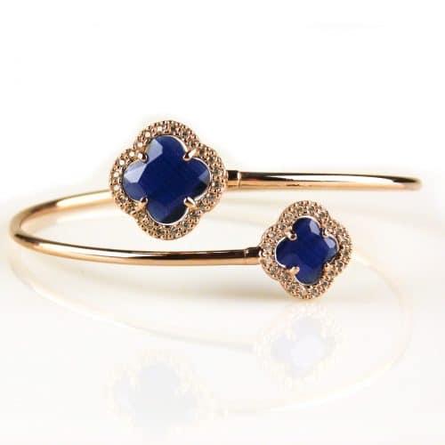 armband esclave in roos goud verguld met donkerblauwe gekleurde stenen bloemen