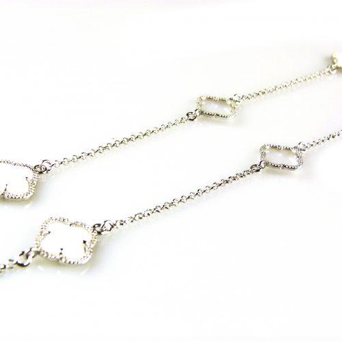 zilveren collier ketting sautoir met witte stenen bloemen klavers