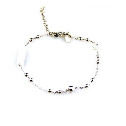 fijne zilveren armband gezet met cubic zirconia en witte email