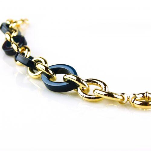 armband goudkleurig brons en blauwe schakels