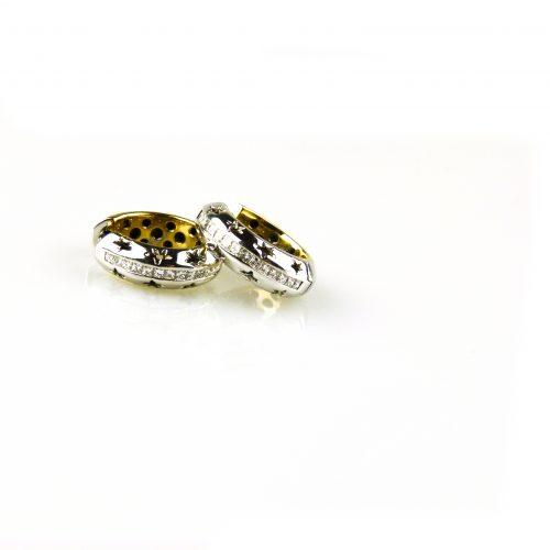 oorbellen oorringen in wit goud en geel goud gezet met diamant princessen