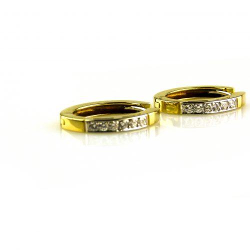 oorbellen oorringen in wit goud en geel goud gezet met diamant