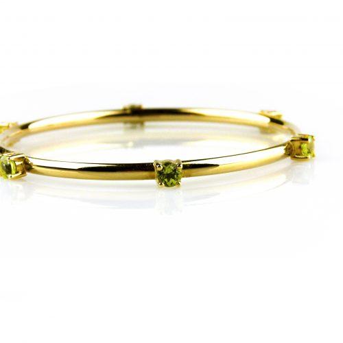 armband in geel goud gezet met peridoot