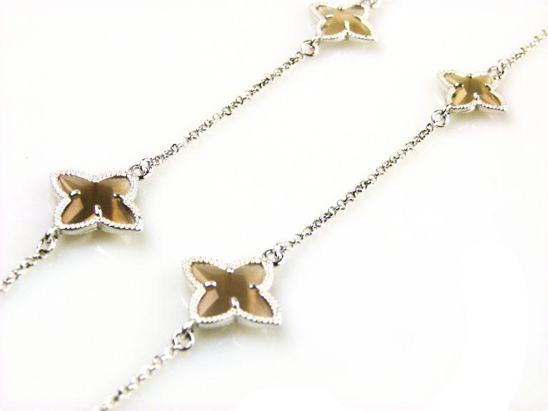zilveren ketting lang bruine stenen ster