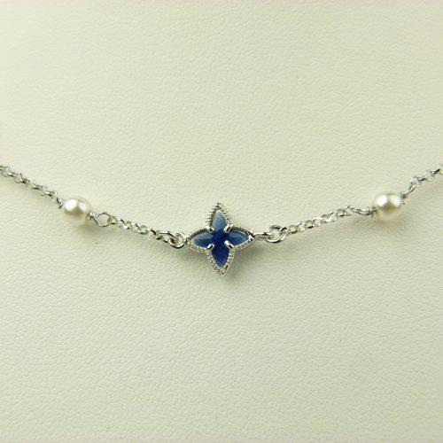 zilveren ketting met donkerblauw steentje ster en parel