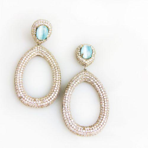 zilveren oorringen oorbellen gezet met blauwe stenen en cubic zirconia