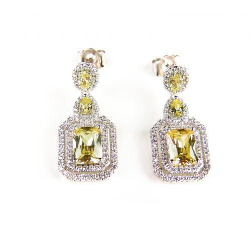 klassieke zilveren oorringen gezet met gele en witte stenen