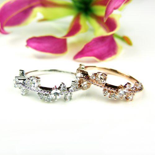 ringen in wit en roos goud gezet met diamant