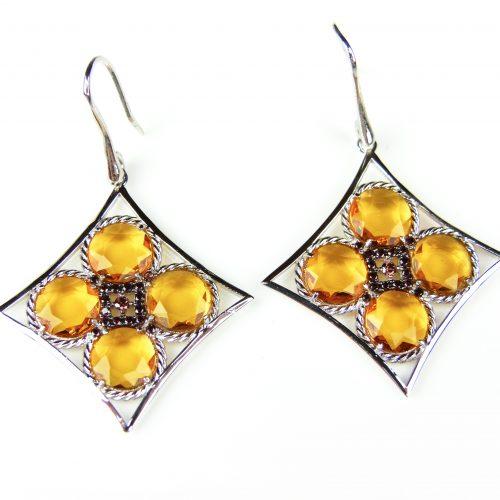 zilveren oorringen oorbellen gezet met gele stenen