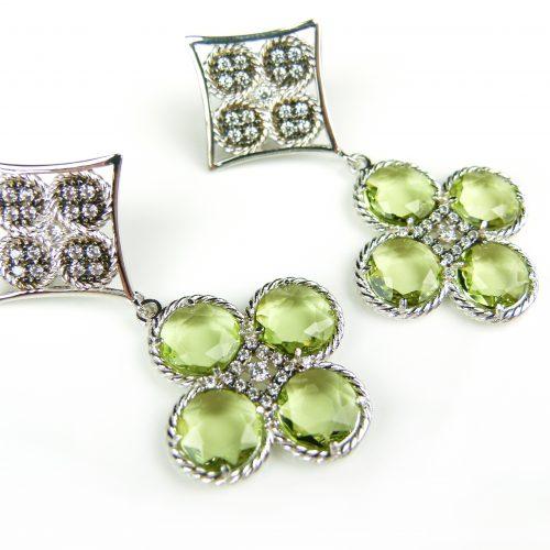 zilveren oorringen oorbellen gezet met groene stenen