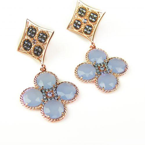 zilveren oorringen oorbellen roos goud verguld gezet met lichtblauwe stenen