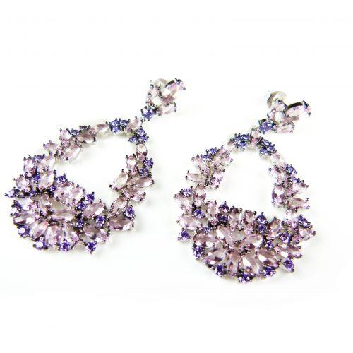 zilveren oorringen oorbellen gezet met paarse en roze stenen
