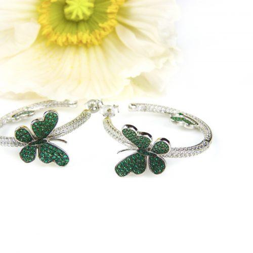 zilveren oorringen oorbellen gezet met groene en witte cubic zirconia