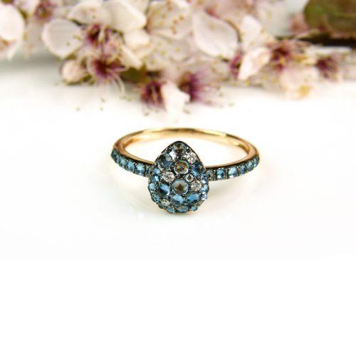 ring in roos goud gezet met londen topaas en diamant