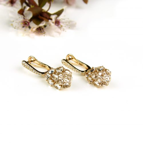 oorringen oorbellen in roos goud gezet met diamant en witte topaas