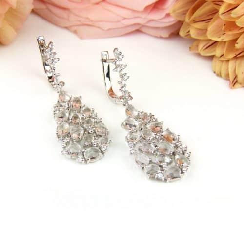 Wit gouden oorringen oorbellen gezet met diamant en witte topazen