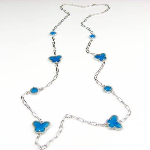 lange zilveren halsketting collier halssnoer gerhodineerd Model Vlinder en Bol met fel blauwe stenen